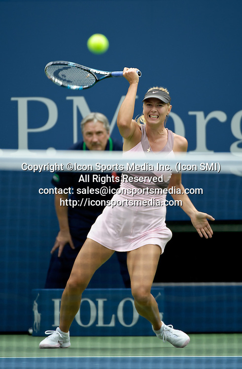 September 5, 2012: Maria Sharapova of Russia (RUS) in action against France's Marion Bartoli (FRA) during their quarterfinal Women's Singles match on Day 10 of the 2012 U.S. Open Tennis Championships at the USTA Billie Jean King National Tennis Center in Flushing, Queens, New York, USA. ***** SWITZERLAND OUT *****