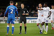 A yellow card for Peterborough Utd defender Jason Naismith (2) during the EFL Sky Bet League 1 match between Peterborough United and Coventry City at London Road, Peterborough, England on 16 March 2019.