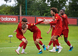 KIRKBY, ENGLAND - Saturday, August 31, 2019: Liverpool's Layton Stewart (C) celebrates the fourth goal with team-mates during the Under-18 FA Premier League match between Liverpool FC and Manchester United at the Liverpool Academy. (Pic by David Rawcliffe/Propaganda)