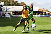 Cambridge United's Greg Taylor(5) tussles with Forest Green Rovers Junior Mondal(25) during the EFL Sky Bet League 2 match between Cambridge United and Forest Green Rovers at the Cambs Glass Stadium, Cambridge, England on 7 September 2019.