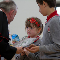 Theresa Brew bringing up Trocaire Box to the Bishop during the officail opening of Ennis National School on Friday
