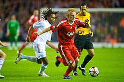 LIVERPOOL, ENGLAND - Wednesday, September 16, 2009: Liverpool's Dirk Kuyt and Debreceni's Luis Ramos during the UEFA Champions League Group E match at Anfield. (Photo by David Rawcliffe/Propaganda)