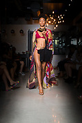 Houston swimsuit model Esmeralda Rojas on runway for Houston Fashion week, by Gerard Harison.