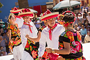Traditional costumed Istmo folk dancers perform outside the Santo Domingo church during the Day of the Dead Festival known in spanish as Día de Muertos on October 26, 2014 in Oaxaca, Mexico.