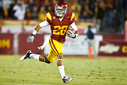 September 11, 2010; Los Angeles, CA, USA;  Southern California Trojans running back Dillon Baxter (28) rushes upfield against the Virginia Cavaliers during the first quarter at the Los Angeles Memorial Coliseum.