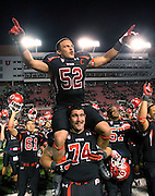 Utah linebacker Matt Martinez (52) and offensive lineman Sam Brenner (74) celebrate with their team after defeating Oregon State 27-8 in an NCAA college football game at Rice-Eccles Stadium, Saturday, Oct. 29, 2011, in Salt Lake City.  (AP Photo/Colin E. Braley).