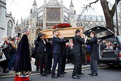 © licensed to London News Pictures. London, UK 27/03/2014.The coffin of Tony Benn leaving St Margaret's Church, Westminster after his funeral at St Margaret's Church, Westminster, London. Former cabinet minister and veteran left-wing campaigner Tony Benn died at home on March 14th following a long term illness. Photo credit: Tolga Akmen/LNP