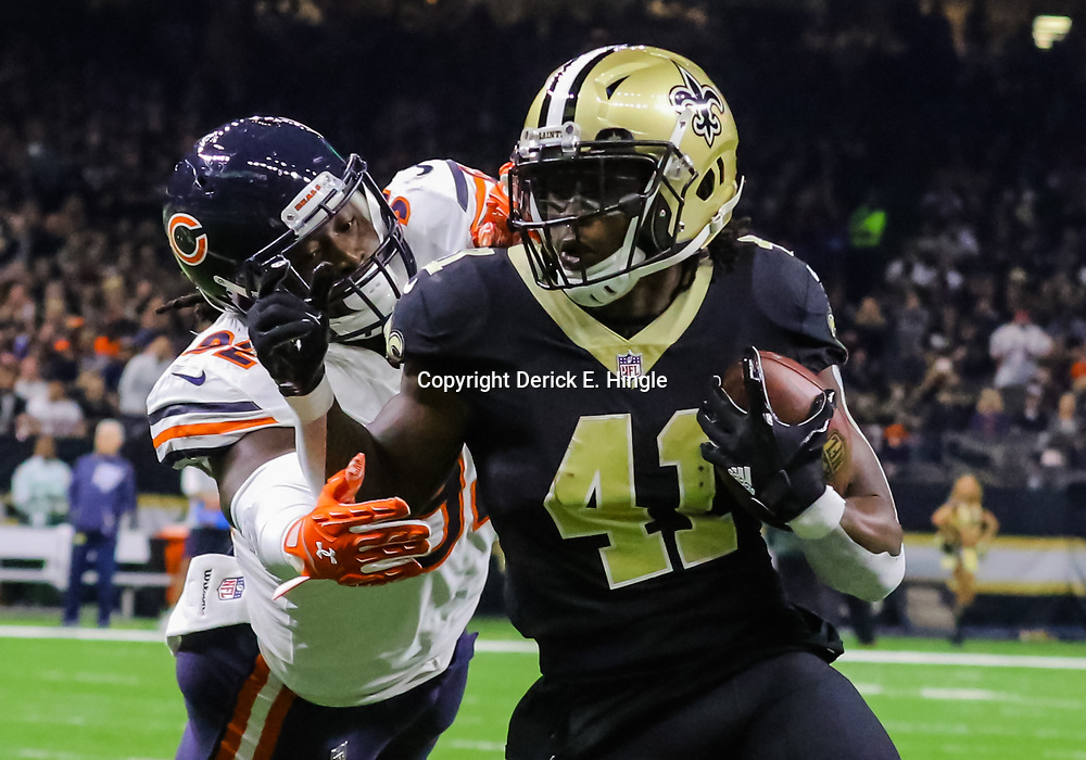 Oct 29, 2017; New Orleans, LA, USA; New Orleans Saints running back Alvin Kamara (41) runs past Chicago Bears linebacker Pernell McPhee (92) for a touchdown during the first quarter of a game at the Mercedes-Benz Superdome. Mandatory Credit: Derick E. Hingle-USA TODAY Sports