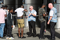 © Licensed to London News Pictures. 27/05/2017. London, UK. Security staff check Arsenal football fans with metal detectors as they enter Wembley stadium for the Emirates FA Cup final. The security level was in response to Manchester Arena bombing when 22 people died and 55 people were injured in one of the most deadly attacks in the UK. Photo credit: Ray Tang/LNP