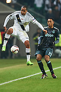 Warsaw, Poland - 2017 February 16: (L) Vadis Odjidja Ofoe of Legia Warsaw fights for the ball with (R) Kenny Tete of Ajax Amsterdam during soccer match Legia Warszawa v Ajax Amsterdam - UEFA Europe League  at Municipal Stadium on February 16, 2017 in Warsaw, Poland.<br /> <br /> Mandatory credit:<br /> Photo by &copy; Adam Nurkiewicz / Mediasport<br /> <br /> Adam Nurkiewicz declares that he has no rights to the image of people at the photographs of his authorship.<br /> <br /> Picture also available in RAW (NEF) or TIFF format on special request.<br /> <br /> Any editorial, commercial or promotional use requires written permission from the author of image.