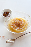 A bowl of homemade applesauce with cinnamon.