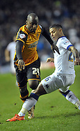 Liam Cooper of Leeds United tackles Sone Aluko of Hull City during the Sky Bet Championship match at Elland Road, Leeds<br /> Picture by Graham Crowther/Focus Images Ltd +44 7763 140036<br /> 05/12/2015