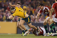 MELBOURNE, 29 JUNE - Michael HOOPER of the Wallabies evades a tackle during the Second Test match between the Australian Wallabies and the British & Irish Lions at Etihad Stadium on 29 June 2013 in Melbourne, Australia. (Photo Sydney Low / asteriskimages.com)