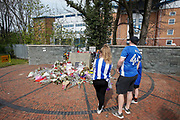 A family of Sheffield Wednesday Supporters pay their respects at the Hillsborough Memorial before the EFL Sky Bet Championship match between Sheffield Wednesday and Bristol City at Hillsborough, Sheffield, England on 22 April 2019.