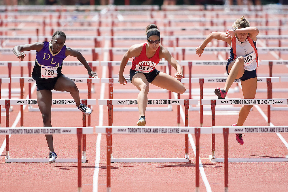 (Toronto, Ontario---3 August 2008)  Jenelle McCalla (129),  Ashlea Maddex (321),  Alexandra Morrow (363)\ competing in the youth girls 100m hurdles final at the 2008 OTFA Supermeet II, the Bantam, Midget, Youth Track and Field Championships. This image is copyright Sean W. Burges, and the photographer can be contacted at www.msievents.com.