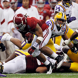 Jan 9, 2012; New Orleans, LA, USA; Alabama Crimson Tide running back Trent Richardson (3) runs with the ball during the second half of the 2012 BCS National Championship game against the LSU Tigers at the Mercedes-Benz Superdome.  Mandatory Credit: Derick E. Hingle-US PRESSWIRE