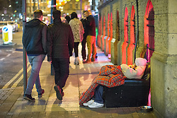 © Licensed to London News Pictures . Manchester , UK . 05/04/2015 . A man with a dog sitting in a sofa chair on Sackville Street , in Manchester City Centre . Revellers on a Saturday night out during the Easter Bank Holiday weekend . Photo credit : Joel Goodman/LNP