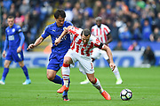 Leicester City forward Shinji Okazaki (20) battles with Stoke City defender Erik Pieters (3) during the Premier League match between Leicester City and Stoke City at the King Power Stadium, Leicester, England on 1 April 2017. Photo by Jon Hobley.