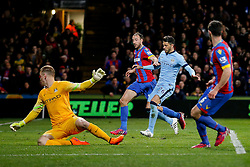 Glenn Murray of Crystal Palace gets past Joe Hart and Martin Demichelis of Manchester City to slot home the cross from Scott Dann of Crystal Palace and score a goal to make it 1-0 - Photo mandatory by-line: Rogan Thomson/JMP - 07966 386802 - 06/04/2015 - SPORT - FOOTBALL - London, England - Selhurst Park - Crystal Palace v Manchester City - Barclays Premier League.
