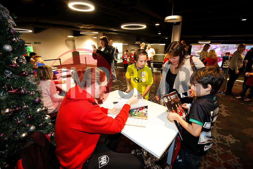 Luke Ayling of Bristol City signs autographs for young fans as Season ticket holders and members of Bristol Sport 7s and Forever Bristol take part in a Bristol Sport Christmas Party - Mandatory byline: Rogan Thomson/JMP - 22/12/2015 - SPORT - Ashton Gate Stadium - Bristol, England - Bristol Sport Christmas at Ashton Gate.