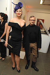 IMMODESTY BLAIZE and JACQUES AZAGURY at a party to celebrate the publication of Vivienne Westwood's Opus held at The Serpentine Gallery, Kensington Gardens, London W2 on 12th February 2008.<br />