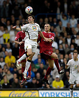 Photo: Jed Wee.<br />Leeds United v Southend United. Coca Cola Championship. 28/10/2006.<br /><br />Leeds' Jonathan Douglas (C) rises highest to win the ball.