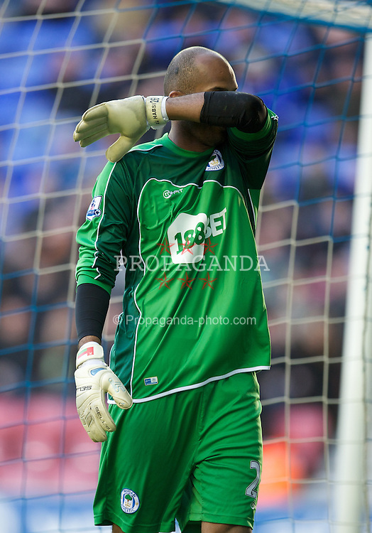 WIGAN, ENGLAND - Saturday, February 26, 2011: Wigan Athletic's goalkeeper Ali Al Habsi looks dejected as his side lose 4-0 to Manchester United during the Premiership match at the DW Stadium. (Photo by David Rawcliffe/Propaganda)