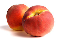Close up of two peaches on white background