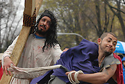 Actors Juan Ponce, 27 (R) and Jesus Ibarro, 21, portray Jesus Christ and his persecutors during a Good Friday Via Crucis in Chicago's Rogers Park neighborhood. The religious portrayal recounts the biblical steps of Jesus Christ being condemned to death, followed by his crucifixion and entombment.