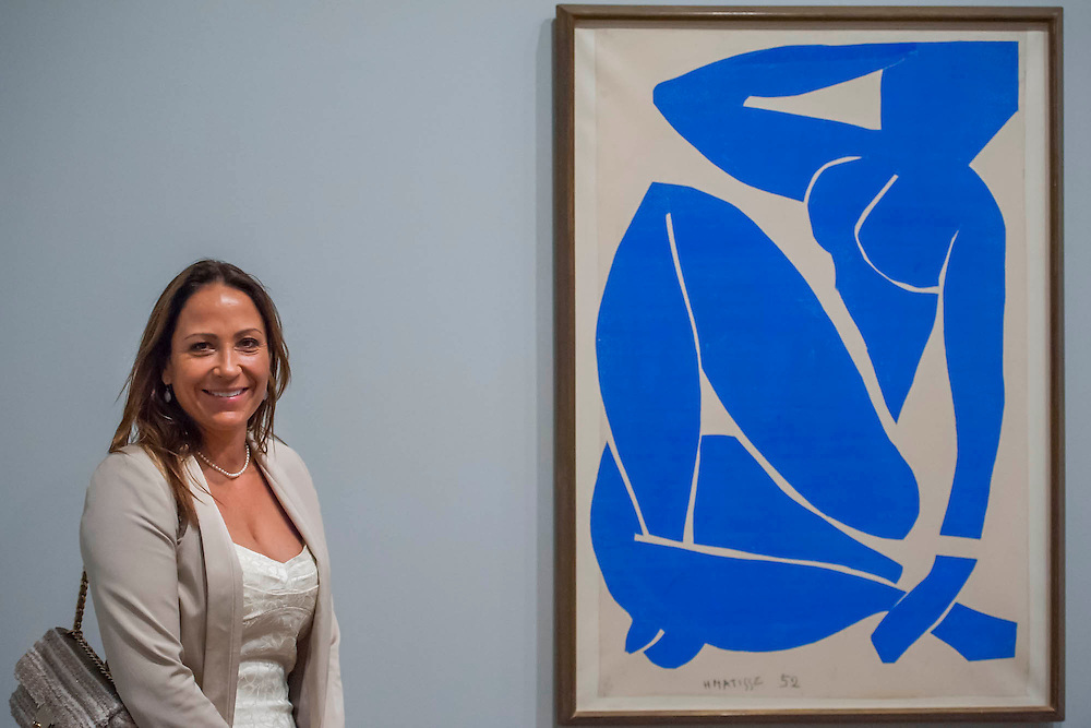 """Sophie Matisse, the artist's great grandaughter, launches the show - here with Blue Nude.Tate Modern's new exhibition, Henri Matisse: The Cut-Outs, is devoted to the artist's paper cut-outs made between 1943 and 1954. It brings together around 120 works, many seen together for the first time, in a """"groundbreaking"""" reassessment of Matisse's colourful and innovative final works. The exhibition opens at Tate Modern on 17 April 2014. They were collected together in Jazz 1947 (Pompidou, Paris), a book of 20 plates. And this will be the first time that the maquettes and the book have been shown together outside of France. Other major cut-outs in the exhibition include Tate's The Snail 1953, its sister work Memory of Oceania 1953 and Large Composition with Masks 1953. The show also includes the largest number of Matisse's Blue Nudes ever exhibited together, including the most significant of the group Blue Nude I 1952. Tate Britain, London, UK."""