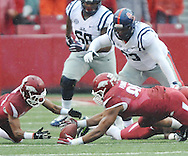 Arkansas Razorbacks defensive end Trey Flowers (86) recovers a fumble by Ole Miss Rebels quarterback Bo Wallace (14) as Arkansas Razorbacks cornerback Jared Collins (29) and Ole Miss Rebels offensive lineman Rod Taylor (73) converge on the ball at Donald W. Reynolds Razorback Stadium in Fayetteville, Ark. on Saturday, November 22, 2014.