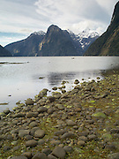 Low-angle view of Mount Pembroke, Stirling Falls and the Harrison River Valley, estuary and bay from Milford Sound; Fiordland National Park, New Zealand