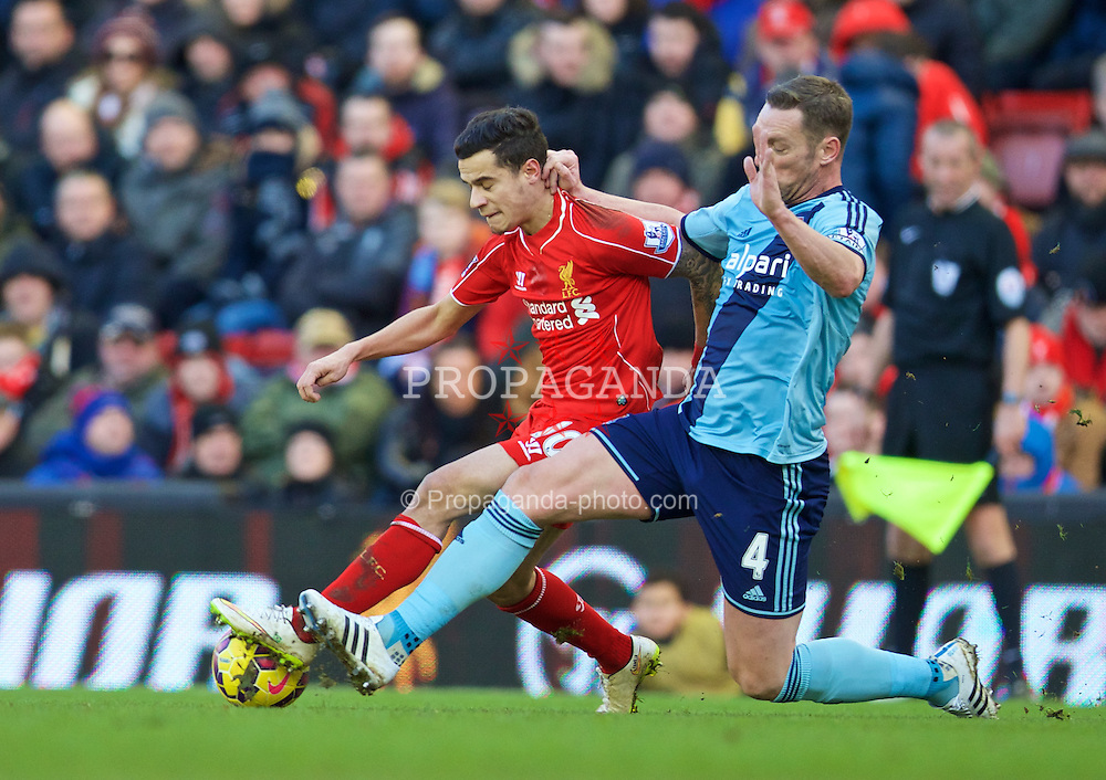 LIVERPOOL, ENGLAND - Saturday, January 31, 2015: Liverpool's Philippe Coutinho Correia in action against West Ham United's captain Kevin Nolan during the Premier League match at Anfield. (Pic by David Rawcliffe/Propaganda)