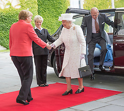 BERLIN-GERMANY- 24-JUNE-2015: Britain's  HM Queen Elizabeth II of her State Visit to Germany visits the Chancellery in Berlin and is met by the German Chancellor, Angela Merkel.<br /> Mrs Merkel led the Queen to her office and showed her the skyline of Berlin from the balcony before sitting down for a cup of tea.<br /> Photograph by Ian Jones
