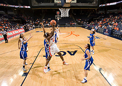 Virginia center Aisha Mohammed (33) grabs a rebound against Morehead St.  The Virginia Cavaliers women's basketball team defeated the Morehead State Eagles 88-43 at the John Paul Jones Arena in Charlottesville, VA on February 4, 2008.