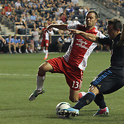 Portland Timbers Midfielder Jack Jewsbury (13) attempts to block Philadelphia Union Midfielder Daniel Cruz (44) pass attempt in the second half a MLS regular season match Saturday, July. 20, 2013 at PPL Park in Chester PA.