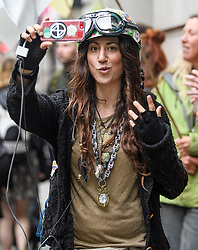 © Licensed to London News Pictures. 08/10/2019. London, UK. Extinction Rebellion activist JOANNA BODIMEADE is seen filming near The Home Office in Westminster. Activists have converged on Westminster for a second day, blockading roads in the area and calling on government departments to 'Tell the Truth' about what they are doing to tackle the Emergency. Photo credit: Ben Cawthra/LNP