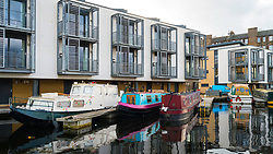 View of new canal side apartments and narrow boats at Lochrin Basin on Union Canal at Fountainbridge in Edinburgh, Scotland, United Kingdom.