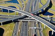 Nederland, Zuid-Holland, Rotterdam, 18-02-2015; Knooppunt Ridderkerk, verkeersknooppunt A15 en A16, bijgenaamd 'Ridderster'. Klaverblad met opritten, afritten en fly-overs. De waterpartijen zijn kunstmatige aangelegd en kunnen dienen als bluswater ingeval van calamiteiten.<br /> Ridderkerk junction, junction A15 / A16, nicknamed 'Ridder star'. Cloverleaf type junction, with ramps, exit ramps and flyovers. The ponds are man-made, the water can be used for firefighting in case of emergencies.<br /> luchtfoto (toeslag op standard tarieven);<br /> aerial photo (additional fee required);<br /> copyright foto/photo Siebe Swart