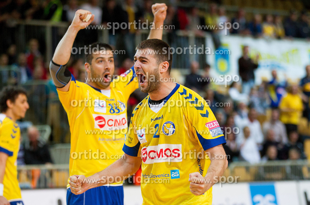 Vladimir Osmajic and Bojan Skoko celebrate during handball match between RK Cimos Koper and RK Celje Pivovarna Lasko of 4th Round of Slovenian National Champion League, on April 14, 2012, in Arena Bonifika, Koper, Slovenia. (Photo by Vid Ponikvar / Sportida.com)