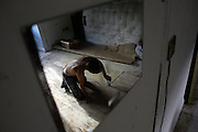 Robert, 25, (left) from Poland is fixing the floor of his room in the Ingram Avenue mansion on Saturday, Sep. 22, 2007, in Hampstead, London, England. The 22-room mansion was last sold for UK£ 3.9M in 2002 and is now awaiting planning permissions to be demolished. Two new houses will soon be taking its place. Million Dollar Squatters is a documentary project in the lives of a peculiar group of squatters residing in three multi-million mansions in one of the classiest residential neighbourhoods of London, Hampstead Garden. The squatters' enthusiasm, their constant efforts to look after what has become their home, their ingenuity and adventurous spirit have all inspired me throughout the days and nights spent at their side. Between the fantasy world of exclusive Britain and the reality of squatting in London, I have been a witness to their unique story. While more than 100.000 properties in London still lay empty to this day, squatting provides a valid, and lawful alternative to paying Europe's most expensive rent prices, as well as offering the challenge of an adventurous lifestyle in the capital.
