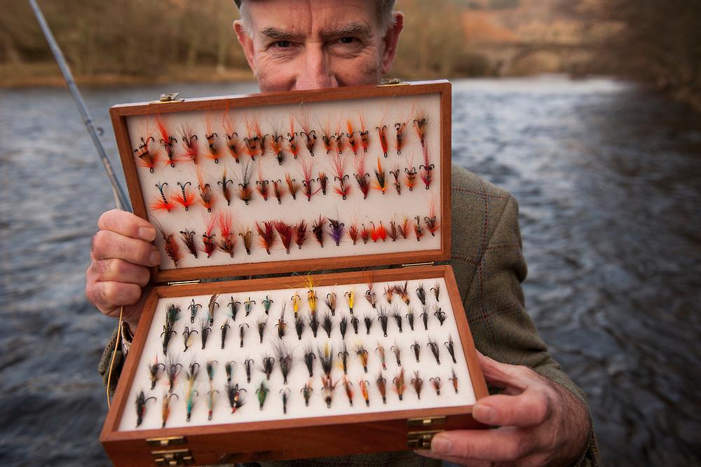In Glenlyon on the River Lyon, Perthshire, Scotland.Fishing gillie for the Glenlyon Estate.Wearing the Glenlyon Estate tweed.  Fortingall Lodge, Scotland