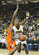 November 29, 2011: Iowa Hawkeyes forward Melsahn Basabe (1) puts up a shot as Clemson Tigers forward/center Devin Booker (31) defends during the first half of the NCAA basketball game between the Clemson Tigers and the Iowa Hawkeyes at Carver-Hawkeye Arena in Iowa City, Iowa on Tuesday, November 29, 2011. Clemson defeated Iowa 71-55 in the Big Ten-ACC Challenge game.