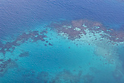 Aerial shot of a coral reef between Savaii and Upolu, Western Samoa.