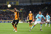 Hull City midfielder Moses Odubajo (2)  heads the ball away during the Sky Bet Championship play-off 2nd leg match between Hull City and Derby County at the KC Stadium, Kingston upon Hull, England on 17 May 2016. Photo by Simon Davies.