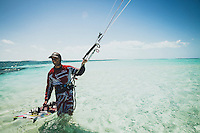 Mike White kite boarding off the shores of Lee Stocking Island and Normans Pond Cay, the Exumas, Bahamas. The water was so shallow along the sandbars it was possible to wade despite being far from land.