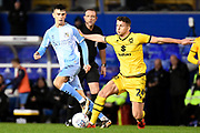 Milton Keynes Dons midfielder Jordan Houghton (24) battles for possession with Coventry City midfielder Zain Westbrooke (25) during the EFL Sky Bet League 1 match between Coventry City and Milton Keynes Dons at the Trillion Trophy Stadium, Birmingham, England on 11 January 2020.