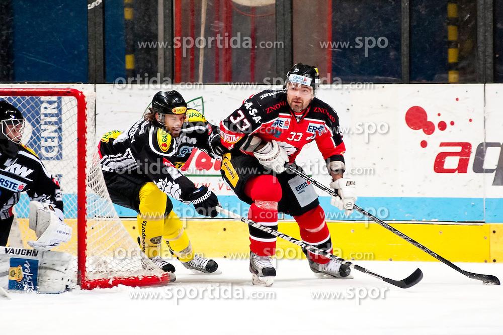 20.12.2013, Hostan Arena, Zneim, CZE, EBEL, HC Orli Znojmo vs Dornbirner EC, 55. Runde, im Bild Peter Pucher (HC Orli Znojmo #33) Kevin Montgomery (Dornbirner #27) // Peter Pucher (HC Orli Znojmo #33) Kevin Montgomery (Dornbirner #27) during the Erste Bank Icehockey League 55th round match between HC Orli Znojmo and Dornbirner EC at the Hostan Arena in Zneim, Czech Republic on 2013/12/20. EXPA Pictures © 2013, PhotoCredit: EXPA/ Rostislav Pfeffer