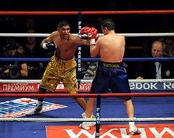 During the WBA Light Welterweight title fight between Amir Khan (Challenger) and Andreas Kotelnik (Champion) at the MEN Arena on July 18, 2009 in Manchester, England.