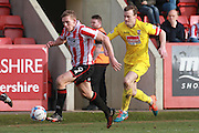 Danny Wright and Mark Ricketts during the Vanarama National League match between Cheltenham Town and Woking at Whaddon Road, Cheltenham, England on 12 March 2016. Photo by Antony Thompson.